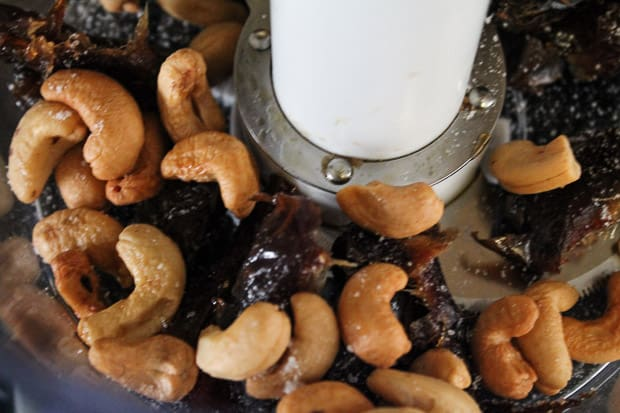 Dates and cashews in a food processor.