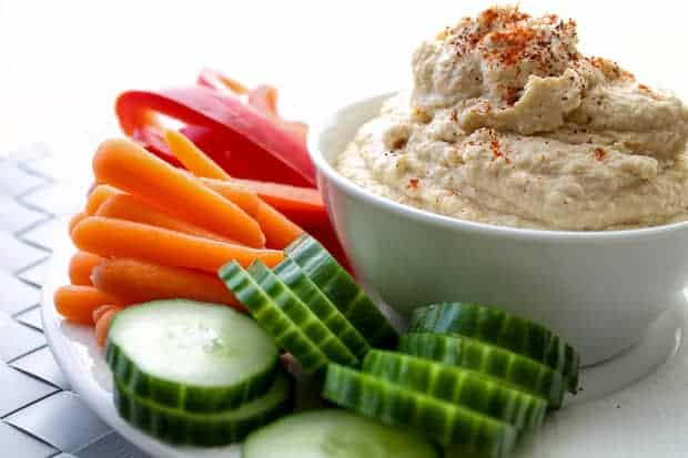 Always a hit, this Classic Hummus will become a staple in your kitchen. Perfect for dipping or using as a spread for pitas or sandwiches. #glutenfree #vegan #recipe