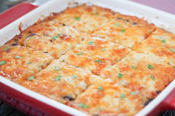 Cheesy casserole in a baking dish, hot and bubbling from the oven.
