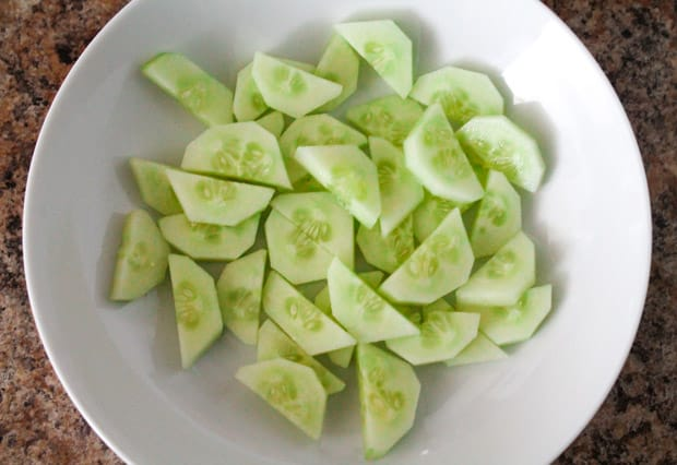 mixing bowl with sliced cucumbers
