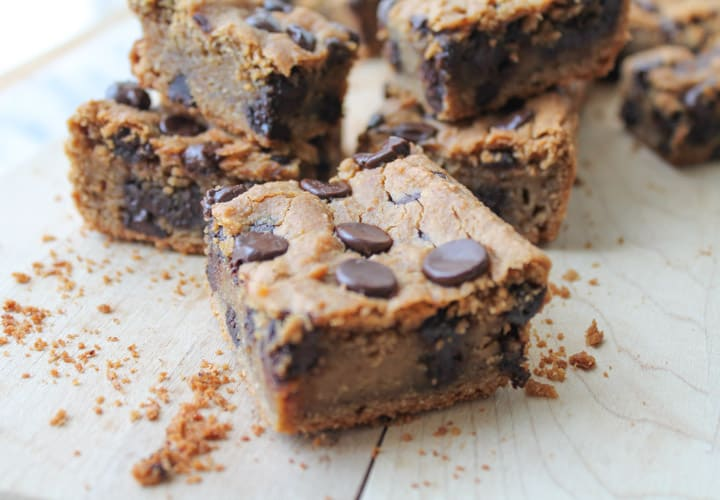Peanut Butter Chocolate Chip Chickpea Cookie Bars on a wooden cutting board