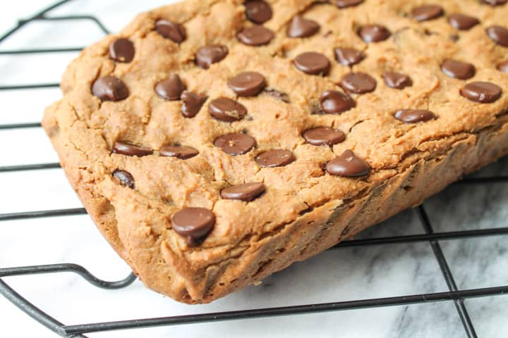 Peanut Butter Chocolate Chip Chickpea Cookie Bar on a wire rack