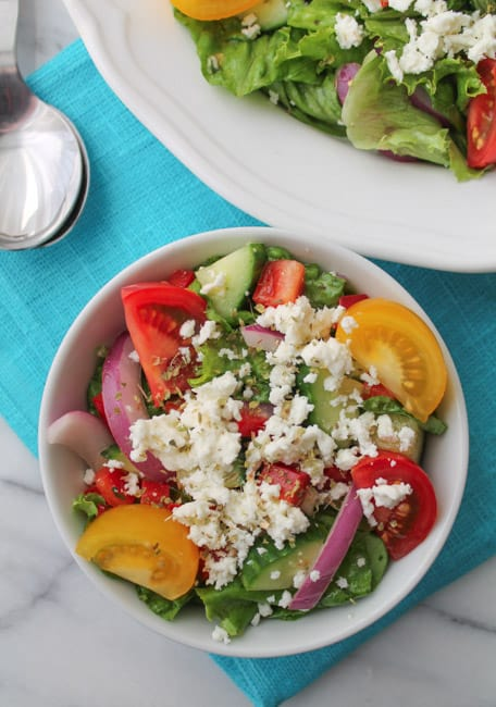 Greek Salad with Minted Lemon Dressing dished out in white bowls