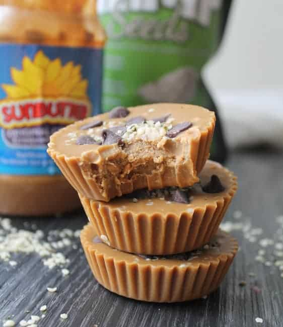 These Sunbutter Cups are such a tasty treat you won't miss that peanut butter. Trust! Topped with dark chocolate and hemp seeds, this snack really satisfies. #nutfree #glutenfree #snacks