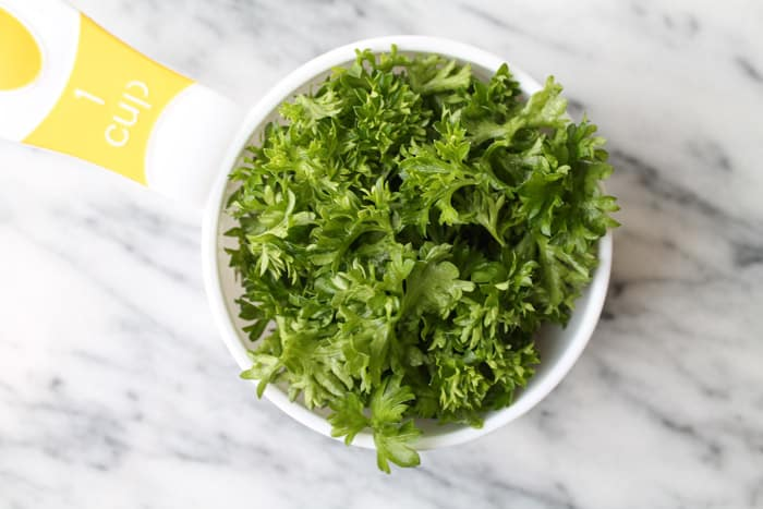 fresh parsley in a measuring cup