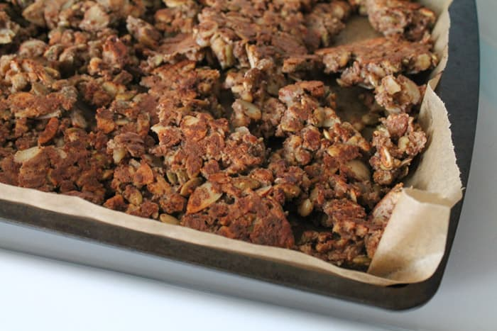 Sugar Free Granola being baked on a sheet lined with parchment paper