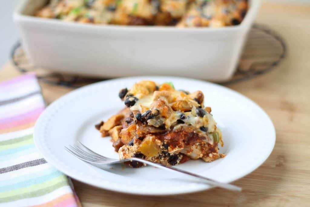 Chicken Enchilada Bake with Butternut Squash & Black Beans in a white baking dish