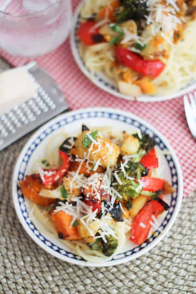 Roasted Vegetable Pasta. Butternut squash, broccoli, carrots and cauliflower get the roasted treatment and are tossed with brown rice pasta and topped with grated Parmesan cheese. #glutenfree #healthy #dinner #recipe