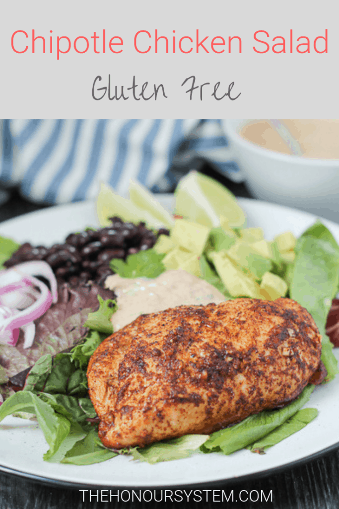 This spicy Chipotle Chicken Salad features chili lime chicken, black beans, avocado and a spicy, fresh and creamy Greek yogurt based chipotle dressing. This easy to make, gluten free salad makes a clean eating lifestyle a delicious one! #glutenfree #chicken #dinner #salad #cleaneating #healthy #recipe #greekyogurt
